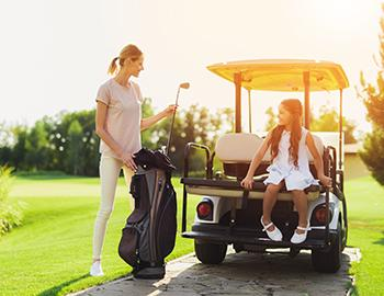 Mother golfing with daughter
