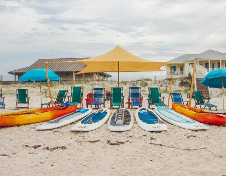 Beach kayaks, paddle boards, chairs and canopy