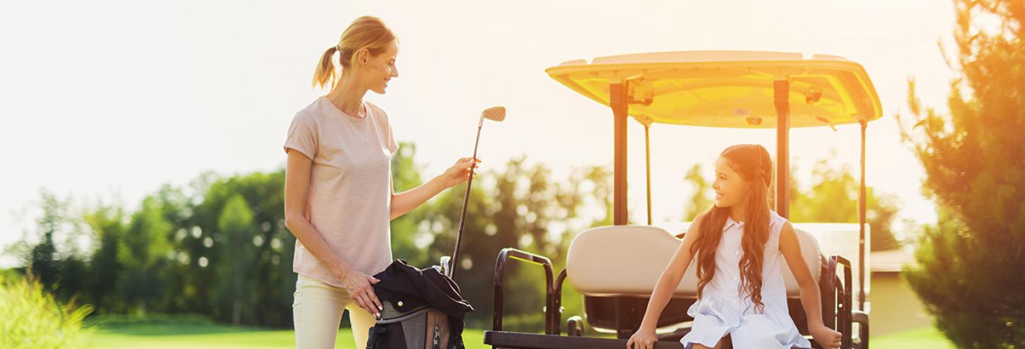 Mom golfing with daughter