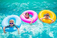 Children swimming in gulf shores beach houses with private pool