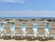 Lounge chairs in front of a pool