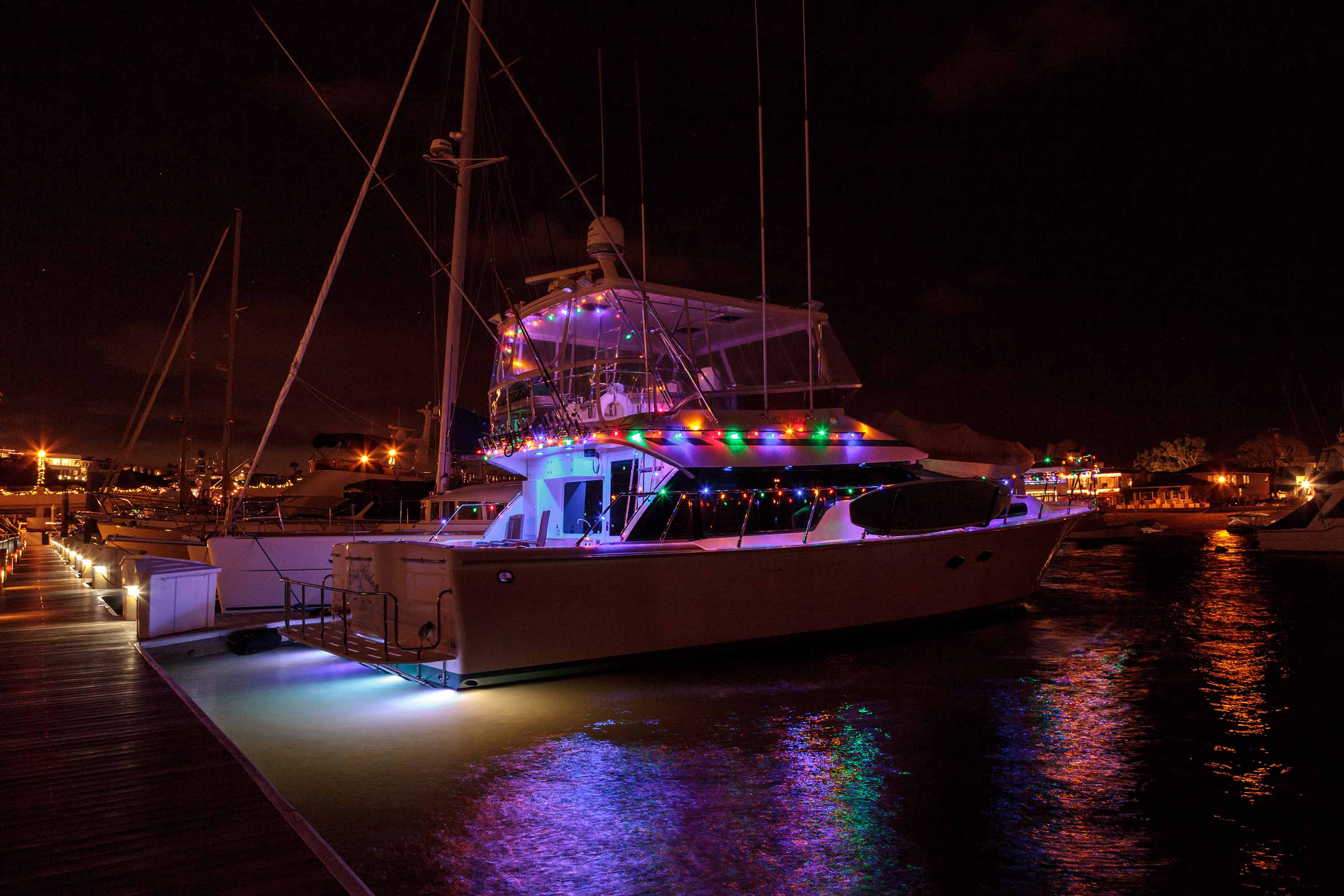 Boat decorated with holiday lights
