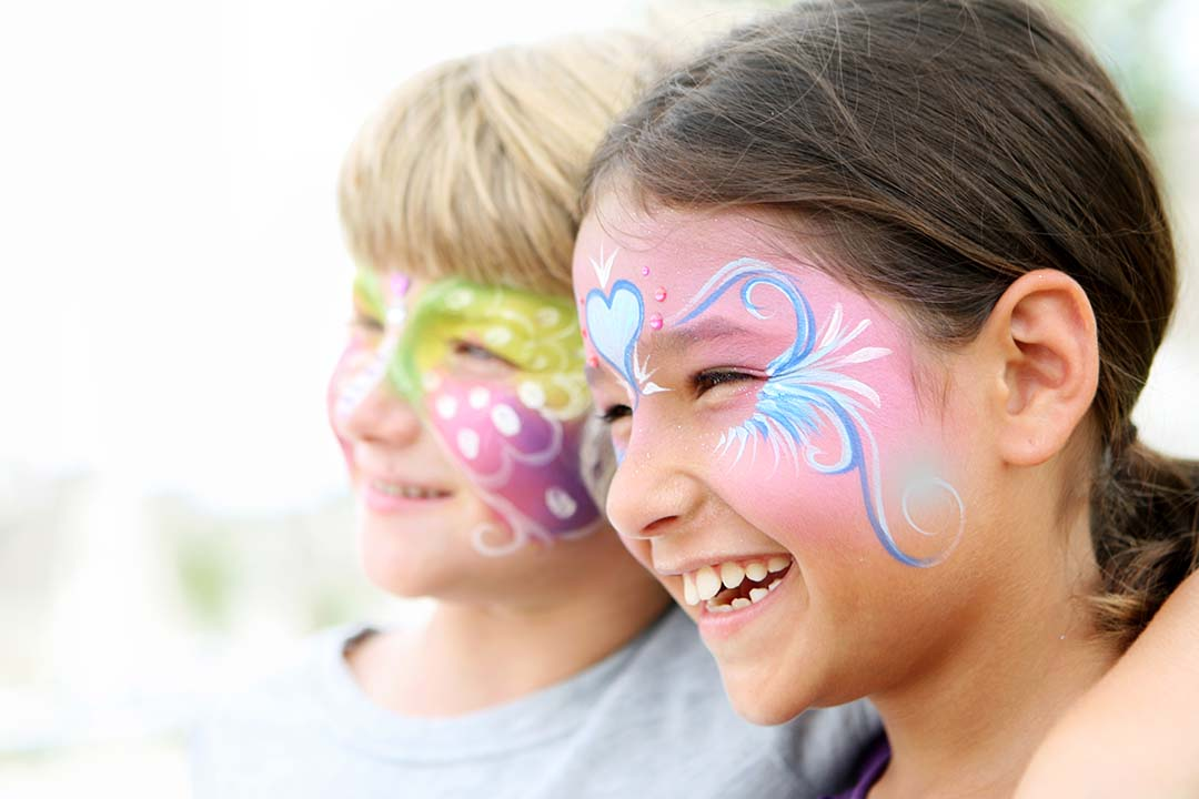 Young boy and girl with facepaint on