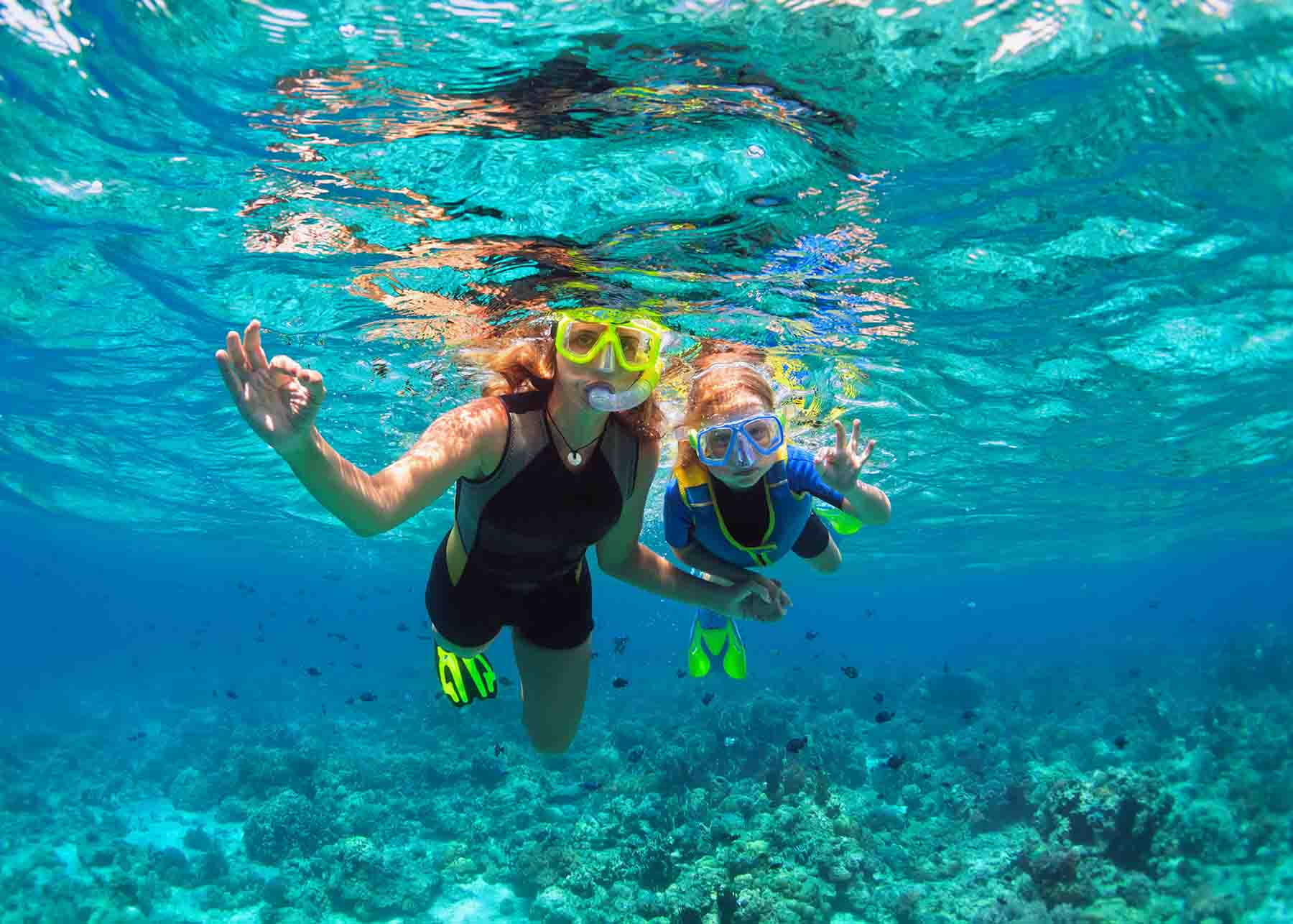 Mom and daughter snorkeling in Gulf Shores